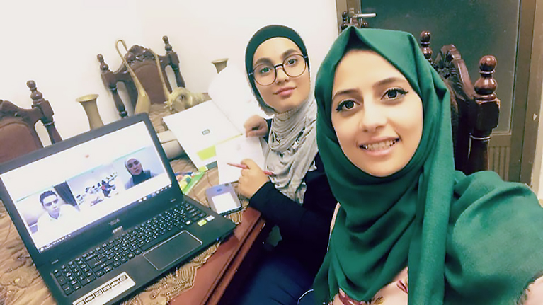 Jordanian students collaborating