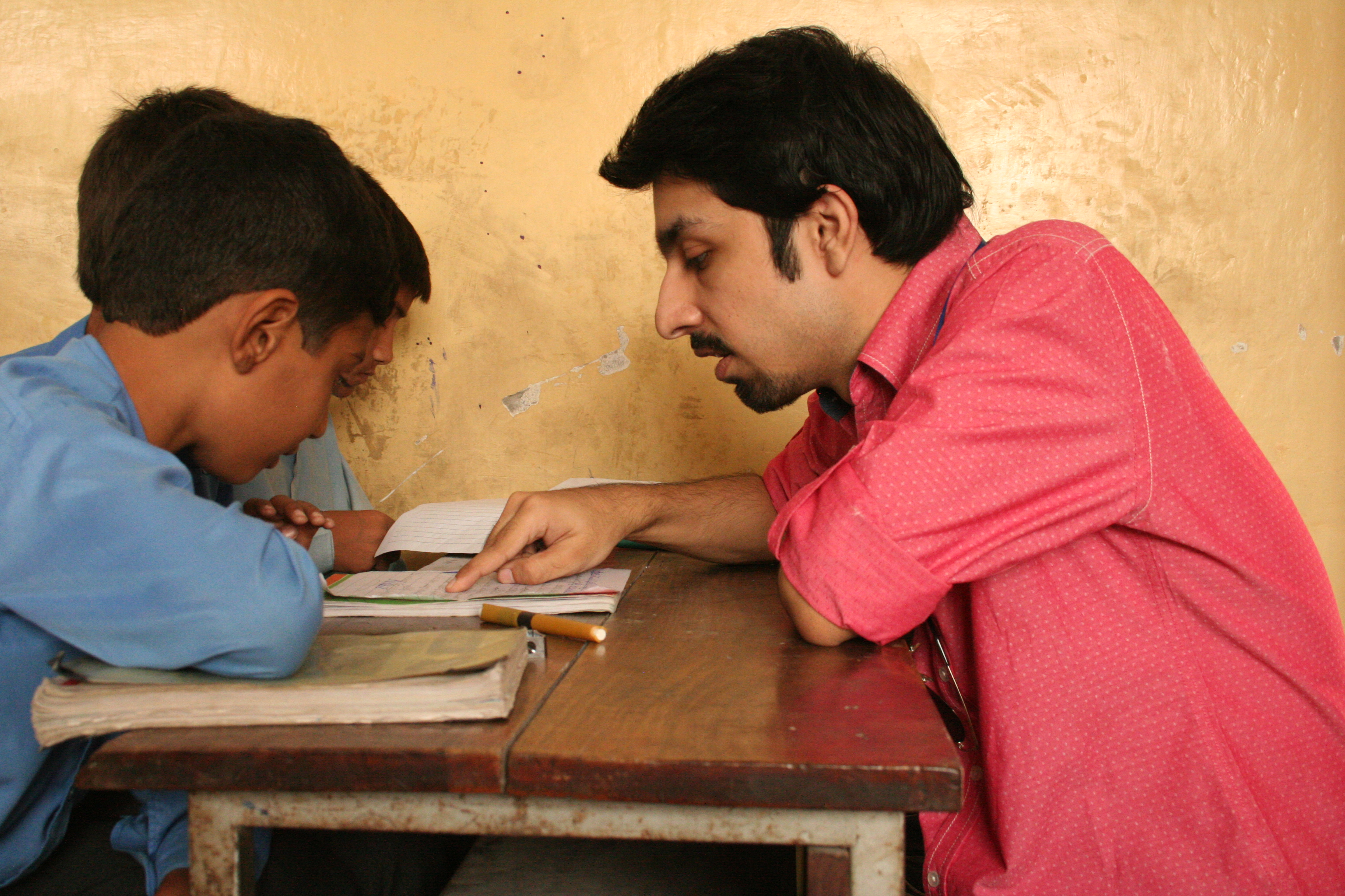 Mujtaba reading with children