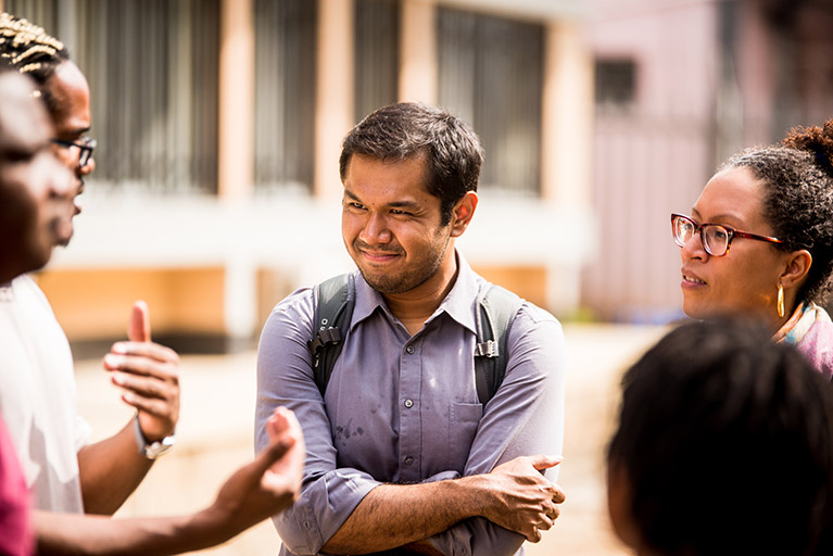 Photo of five participants having a conversation