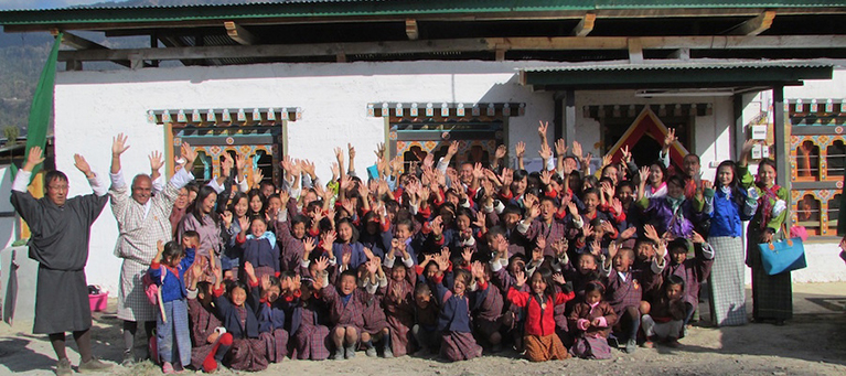 Community members celebrate opening a new READ Center in Bhutan