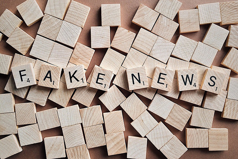 Scrabble pieces that spell the words fake news