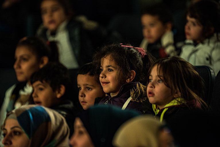 Photo of students watching a play in Jordan