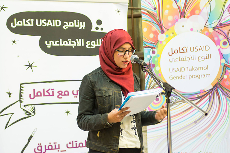 A young woman performs at a poetry slam