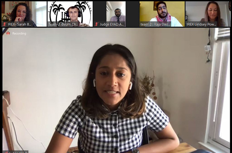 Screenshot from a video conference with six people.