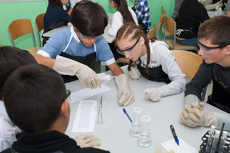Students collaborating on a science lab activity in Georgia