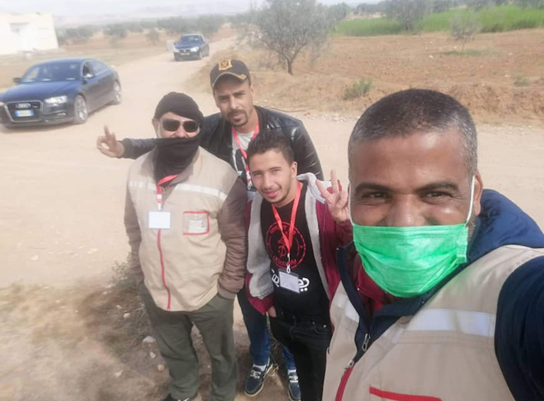 Ma3an youth Houssem and other local crisis unit members spread news of COVID-19 to residents residing outside of the Souk Jedid community center