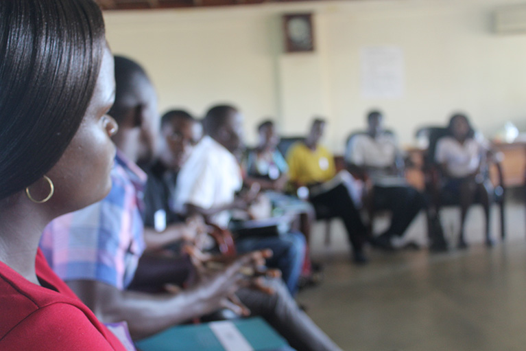 Photo of a circle of young people from a youth-led labor market assessment in Uganda.