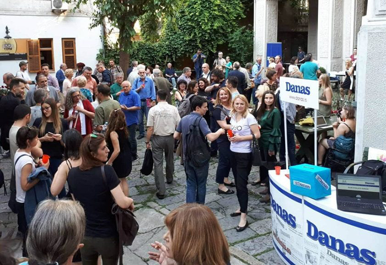 Community members celebrate Danas's successful online membership campaign in Serbia.