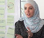 Photo of a facilitator conducting a training session in Jordan