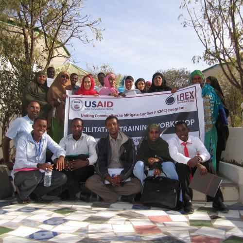 Project staff and participants with a banner about a project