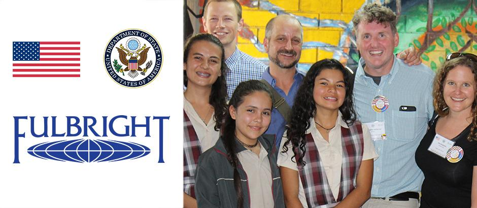 US flag, seal of the US Department of State, Fulbright logo, and photo of US teachers in front of a mural