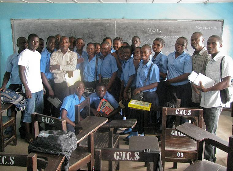 Teacher and students in a classroom in Africa